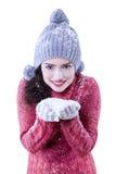 Pretty indian woman holding snow Stock Photos
