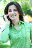Pretty Indian Woman on Phone. A pretty, ethnic woman on the phone outside Royalty Free Stock Image