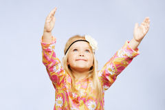 Pretty inspired little girl Stock Images