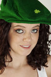 Pretty Irish Lass. Beautiful and sexy Irish girl wearing a beret with a shamrock on it Stock Photography