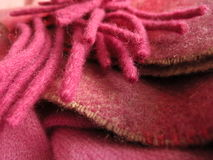 Pretty Irish wool scarf in balanced layers. One hundred percent Irish wool scarf, with fringe and layers equally balanced, in pink and fuchsia Stock Images