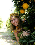 Pretty islam woman in orange grove smiling Stock Photo