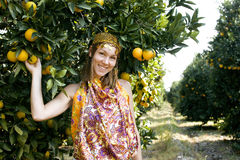 Pretty islam woman in orange grove smiling Stock Photos