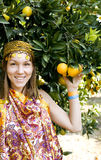 Pretty islam woman in orange grove smiling Royalty Free Stock Image