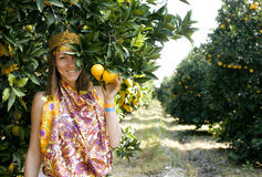 Pretty islam woman in orange grove smiling Royalty Free Stock Photos