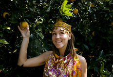 Pretty islam woman in orange grove smiling Royalty Free Stock Photos