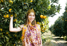 Pretty islam woman in orange grove smiling, real Stock Photography