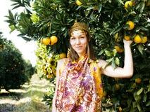 Pretty islam woman in orange grove smiling, real muslim girl Royalty Free Stock Photo