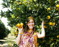 Pretty islam woman in orange grove smiling Royalty Free Stock Photography