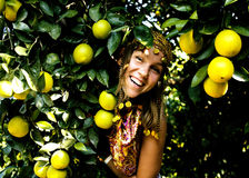 Pretty islam woman in orange grove smiling, real muslim girl che Royalty Free Stock Photography