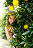 Pretty islam woman in orange grove smiling, real muslim girl che Stock Photos