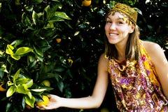 Pretty islam woman in orange grove smiling, real muslim girl che. Erful close up stock photo