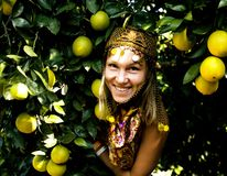 Pretty islam woman in orange grove smiling, real muslim girl che. Erful close up stock images