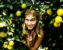 Pretty islam woman in orange grove smiling, real muslim girl che. Erful close up royalty free stock photography