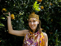 Pretty islam woman in orange grove smiling, real Royalty Free Stock Images