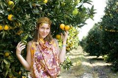 Pretty islam woman in orange grove smiling, real muslim girl cheerful Stock Photo