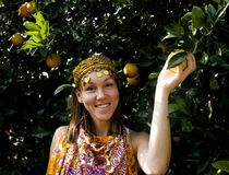 Pretty islam woman in orange grove smiling. Real muslim girl close up royalty free stock images