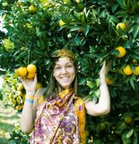 Pretty islam woman in orange grove smiling, real muslim girl. Closeup royalty free stock photos