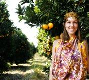 Pretty islam woman in orange grove smiling, real muslim girl Stock Photos