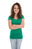 Pretty isolated young woman in green shirt and blue jeans isolat Royalty Free Stock Photo