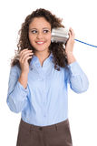 Pretty isolated young woman on the tin can phone: communication Royalty Free Stock Images