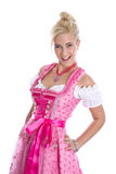 Pretty isolated young woman wearing bavarian dress called dirndl royalty free stock images