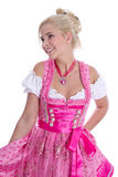Pretty isolated young woman wearing bavarian dress called dirndl Royalty Free Stock Image