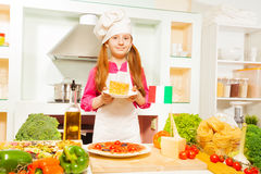 Pretty Italian girl holding plate with cheese Stock Photos