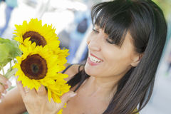 Pretty Italian Woman Looking at Sunflowers at Market Royalty Free Stock Photos