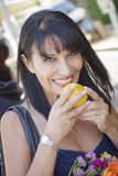Pretty Italian Woman Smelling Oranges at the Street Market Royalty Free Stock Image