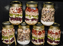 Pretty jar meals mainly beans. Different canning jars filled with meals ready to prepare. These jar meals make great gifts, and pretty accents for the home royalty free stock photos
