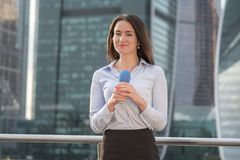 Pretty journalist on business center background Stock Image