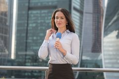 Pretty journalist on business center background Stock Photo