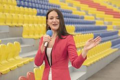 Journalist is reporting from the stadium for television Royalty Free Stock Photography