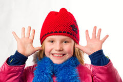 Pretty joyful little girl dressed winter clothes Royalty Free Stock Photo