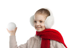 Pretty joyful little girl in warm winter things with knitted scarf Royalty Free Stock Images