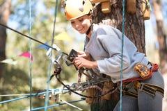 Pretty joyful woman fastening the carabiner Stock Images