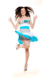 Pretty jumping brunette Stock Photos