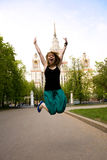 Pretty jumping student. Pretty student jumping in front of the Moscow State University, Russia Royalty Free Stock Photos
