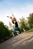 Pretty jumping student. Pretty student jumping in front of the Moscow State University, Russia Stock Photography