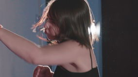 Pretty kickboxing woman training punching bag in sport studio. Slowly stock video footage