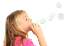 Pretty Kid Blowing Bubbles Stock Photography