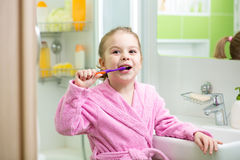 Pretty kid brushing teeth Stock Photography