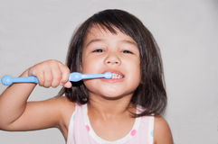 Pretty Kid Brushing Teeth Royalty Free Stock Images