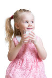 Pretty kid drinking milk from glass. Kid Girl drinking yoghurt from glass isolated Royalty Free Stock Image