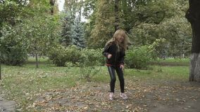 Pretty kid jumps in the park stock footage