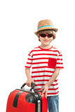 Pretty kid with a red suitcase Stock Photos