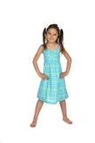 Pretty kindergarten aged child in blue dress Stock Photo