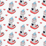 Pretty Kitten in Blue Hat and Red Pillow. Vector. Pretty kitten in blue hat and red pillow. Saint Valentine s day concept. Seamless pattern with cat in warm Royalty Free Stock Image