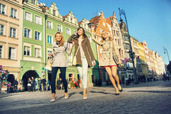 Pretty ladies in the crowdy downtown Stock Images